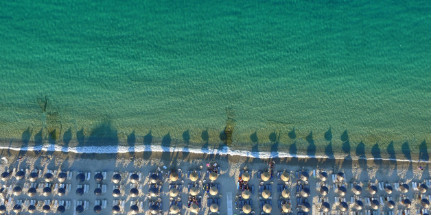 HALKIDIKI, GREECE - JUNE 23: Aerial view of The Pefkochori beach with umbrellas on June 23, 2015 in Halkidiki, Greece. Pefkochori is a tourist town located in the southeast of the peninsula of Kassandra and named after the pine trees which are abundant in the mountains of the area. (Photo by Athanasios Gioumpasis/Getty Images)