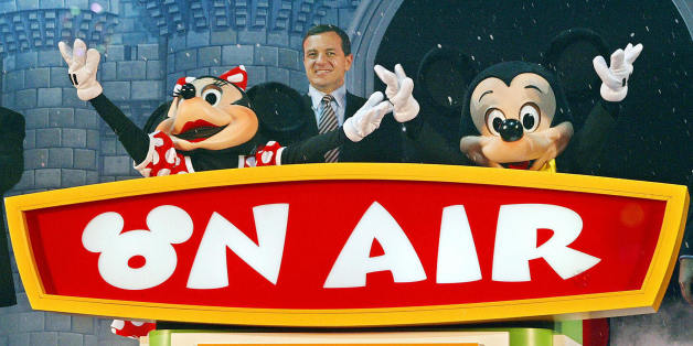 TOKYO, JAPAN:  President and chief operating officer Rob Iger (C), Mickey Mouse (R) and Minnie Mouse (L) attend the launch of the 24-hour Disney exclusive channel 'Disney Channel' in Japan, during the opening ceremony in Tokyo, 18 Noember 2003.  The launch coincides to mark the 75th birthday of Mickey Mouse.        AFP PHOTO/Toru YAMANAKA  (Photo credit should read TORU YAMANAKA/AFP/Getty Images)
