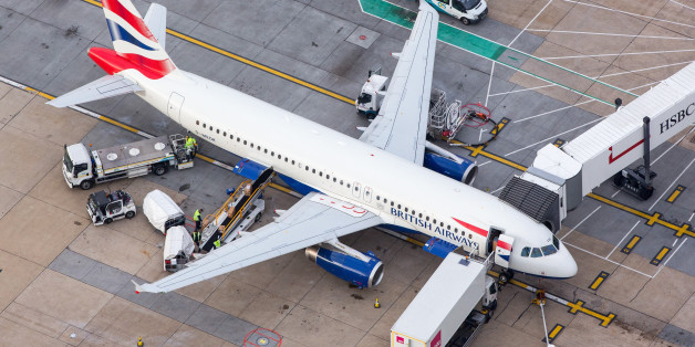 Luggage is loaded onto a passenger aircraft, operated by British Airways, a unit of International Consolidated Airlines Group SA (IAG), at London Gatwick airport in this aerial view taken over Crawley, U.K., on Monday, Oct. 24, 2016. The U.K. government will decide next week whether to expand London's main airport, Heathrow, or its rival Gatwick putting an end to decades of prevarication over what has become one of the most contentious issues in British politics. Photographer: Jason Alden/Bloomb