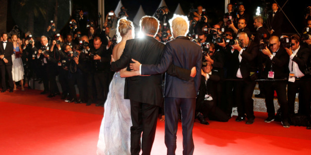 """Actor and director Sean Penn poses with his children actor Hopper Jack Penn (R) and actress Dylan Penn (L) on red carpet as they leave after the screening of the film """"The last Face"""" in competition at the 69th Cannes Film Festival in Cannes, France, May 20, 2016.REUTERS/Regis Duvignau"""