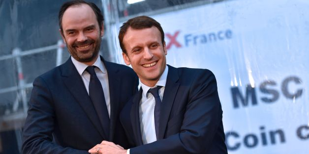 French Economy Minister Emmanuel Macron (R) shakes hand with mayor of Le Havres Edouard Philippe during the MSC Meraviglia cruise ship coins ceremony at the STX shipyards, on February 1, 2016 in Saint-Nazaire, western France. / AFP / LOIC VENANCE        (Photo credit should read LOIC VENANCE/AFP/Getty Images)