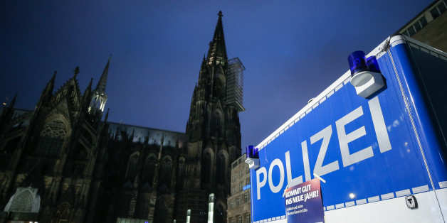 COLOGNE, GERMANY - DECEMBER 31: Police van is seen in front of Cologne Cathedral not far from where on New Year's Eve one year ago hundreds of apparently coordinated sexual assaults were perpetrated against women, prior to New Year's Eve celebrations on December 31, 2016 in Cologne, Germany. City authorities have deployed around 1,500 police officers - more than 10 times last year's number, to maintain security during this year's festivities. Security across Germany is high due also to the recen