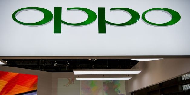 People visit the Oppo stand at the Mobile World Congress on the third day of the MWC in Barcelona, on March 1, 2017. 