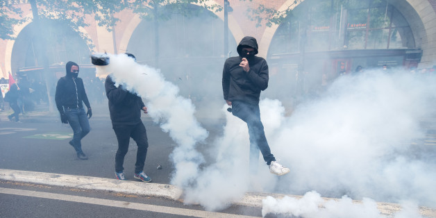 Demonstrators confront police on the annual May Day worker's march on May 1, 2017 in Paris, France. Police dealt with violent scenes in central Paris during the rally held close to the Place de la Bastille. The violent riot of the first may 2017, causing 6 policemen wounded may molotov coktail, and 5 protester arerested.