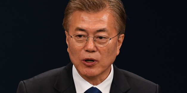 SEOUL, SOUTH KOREA - MAY 10:  South Korea's new President Moon Jae-In speaks during a press conference at the presidential Blue House on May 10, 2017 in Seoul, South Korea. Moon Jae-in of Democratic Party, was elected as the new president of South Korea in the election held on May 9, 2017.  (Photo by Kim Min-Hee-Pool/Getty Images)