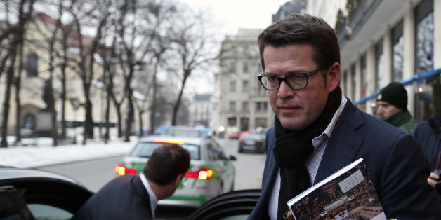 Former German Defense Minister Karl-Theodor zu Guttenberg arrives at 'Bayerischer Hof' hotel for the 51st Munich Security Conference in Munich February 6, 2015.  REUTERS/Michaela Rehle (GERMANY  - Tags: MILITARY POLITICS)