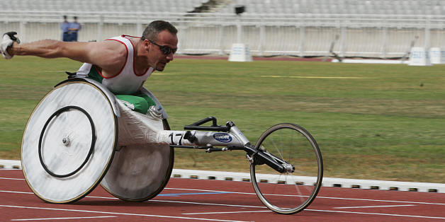 Algiers, ALGERIA: Algeria's Bouadda Mohamed races to win the gold medal 15 July 2007 in the handisport 200m-Men T54 final at the 9th All-African-Games 2007 in Algiers. Deprived of international competition for 15 years due to the threat of Islamic terrorism, Algeria is primed and ready to host the ninth edition of the All-African Games, from 11 to 23 July 2007. AFP PHOTO / Fayez NURELDINE (Photo credit should read FAYEZ NURELDINE/AFP/Getty Images)