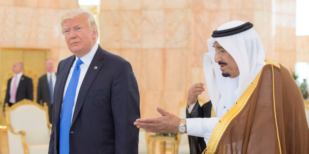 Saudi Arabia's King Salman bin Abdulaziz Al Saud welcomes U.S. President Donald Trump during a reception ceremony in Riyadh, Saudi Arabia, May 20, 2017. Bandar Algaloud/Courtesy of Saudi Royal Court/Handout via REUTERS ATTENTION EDITORS - THIS PICTURE WAS PROVIDED BY A THIRD PARTY. FOR EDITORIAL USE ONLY.
