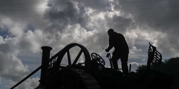 EXETER, ENGLAND - MAY 18:  A man oils his steam engine being displayed at the 122nd Devon County Show at the Westpoint Arena and Showground in Clyst St Mary near Exeter on May 18, 2017 in Devon, England. Established in 1872 it has grown into one of the South West's biggest county shows and is often seen as a curtain raiser for the whole showing season. Although primarily a agricultural livestock and produce showcase, it is also seen as a barometer for the health of the whole agricultural industr