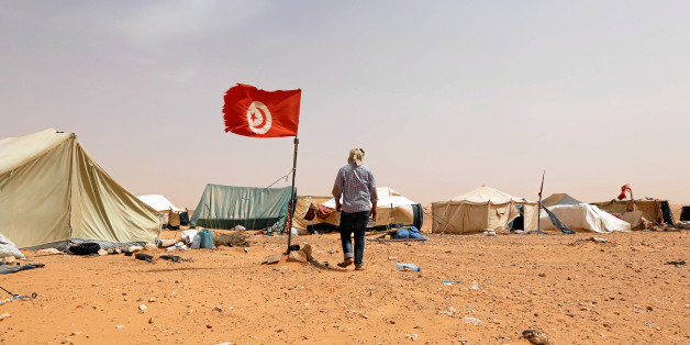A Tunisian protester walks near his tent during a sit-in at El Kamour oilfield, near the town of Tatouine, Tunisia May 11, 2017. Picture taken May 11, 2017. REUTERS/Zoubeir Souissi