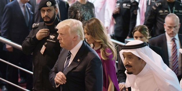 US President Donald Trump (C) and Saudi Arabia's King Salman bin Abdulaziz al-Saud (R) take part in a welcome ceremony ahead of a banquet at Murabba Palace in Riyadh on May 20, 2017. / AFP PHOTO / MANDEL NGAN        (Photo credit should read MANDEL NGAN/AFP/Getty Images)