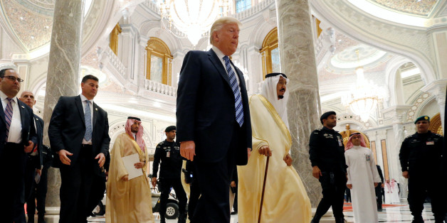 U.S. President Donald Trump walks with Saudi Arabia's King Salman bin Abdulaziz Al Saud to deliver remarks to the Arab Islamic American Summit in Riyadh, Saudi Arabia May 21, 2017. REUTERS/Jonathan Ernst