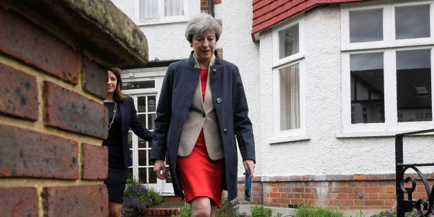British Prime Minister Theresa May goes canvassing door to door with local Conservative candidate Joy Morrissey (L) in Ealing in west London on May 20, 2017, as campaigning continues in the build up to the general election on June 8.  / AFP PHOTO / POOL / TOBY MELVILLE        (Photo credit should read TOBY MELVILLE/AFP/Getty Images)