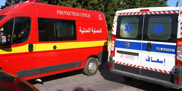SOUSSE, TUNISIA - JUNE 26: An ambulance seen at the attack site after gunmen stormed a popular tourist resort on June 26, 2015 in Sousse, Tunisia.  The shocking pictures taken on a mobile phone show some of the victims gunned down near the Imperial Marhaba hotel. At least 37 are confirmed dead after gunmen opened fire at a hotel popular with British and European holidaymakers.  PHOTOGRAPH BY Mohamed Krit / Barcroft Media (Photo credit should read Mohamed Krit / Barcroft Media via Getty Images)