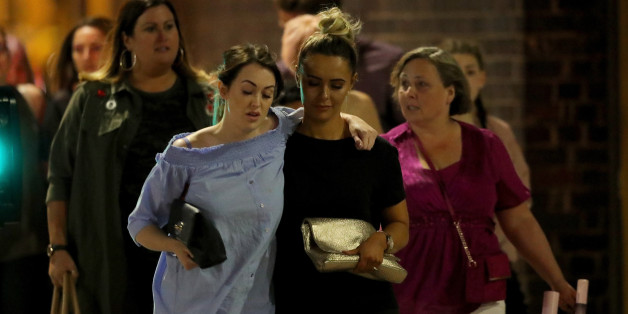MANCHESTER, ENGLAND - MAY 23:  Police escort members of the public from the Manchester Arena on May 23, 2017 in Manchester, England.  An explosion occurred at Manchester Arena as concert goers were leaving the venue after Ariana Grande had performed.  Greater Manchester Police have confirmed 19 fatalities and at least 50 injured. (Photo by Christopher Furlong/Getty Images)