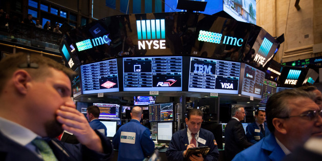 Traders work on the floor of the New York Stock Exchange (NYSE) in New York, U.S., on Monday, May 22, 2017. U.S. stocks advanced for a third day as President Donald Trump's trip to Saudi Arabia netted deals that lifted industrial shares and crude pushed above $50 a barrel before OPEC meets this week. Photographer: Michael Nagle/Bloomberg via Getty Images