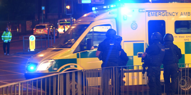 Armed police stand guard at the scene of a suspected terrorist attack during a pop concert by US star Ariana Grande in Manchester, northwest England on May 23, 2017. / AFP PHOTO / Paul ELLIS        (Photo credit should read PAUL ELLIS/AFP/Getty Images)