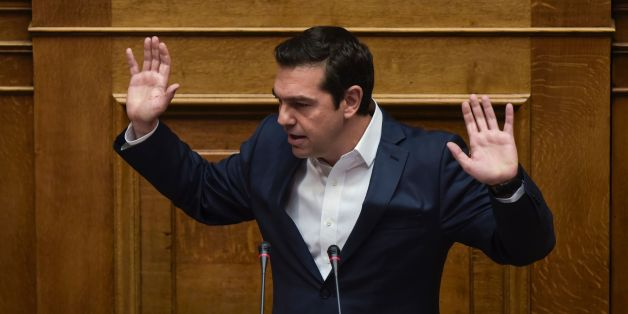 Greek Prime Minister Alexis Tsipras gestures as he delivers a speech during a parliamentary session in Athens on May 18, 2017. 