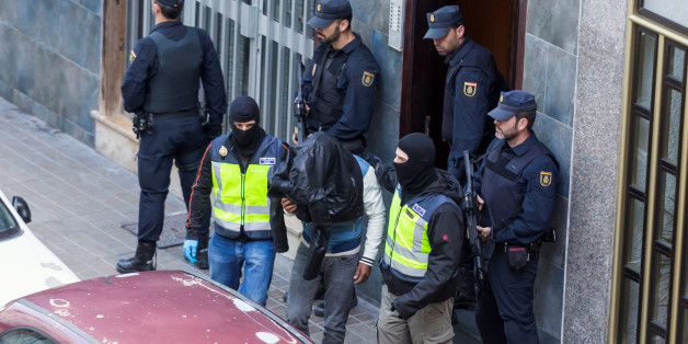 A man (C) suspected of belonging to Islamic State is led by Spanish National Police officers after being detained in Las Palmas, Spain, February 14, 2017. REUTERS/Borja Suarez