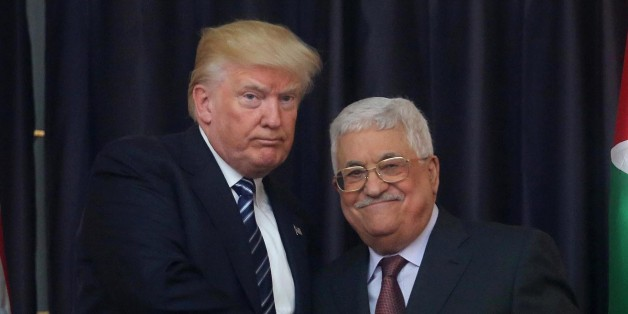 BETHLEHEM, WEST BANK - MAY 23:  Palestinian president Mahmoud Abbas (R) and  US President Donald Trump (L) shake hands during their joint press conference following their meeting on May 23, 2017 in Bethlehem, West Bank.  (Photo by Issam Rimawi/Anadolu Agency/Getty Images)