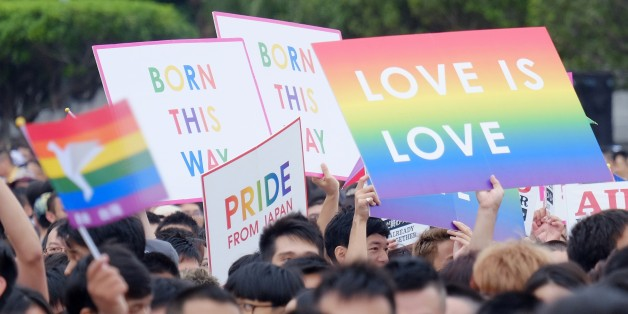 To go with Taiwan-social-election-gay-rights-marriage,FOCUS by Michelle Yun This photo taken on October 31, 2015 shows local residents taking part in the annual gay rights parade in Taipei. Taiwan's presidential elections in January are expected to usher in a new political era, and many hope it will also see the island become the first Asian power to legalise same-sex marriage. AFP PHOTO / Sam Yeh / AFP / SAM YEH        (Photo credit should read SAM YEH/AFP/Getty Images)