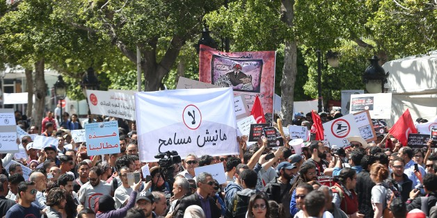 TUNIS, TUNISIA - APRIL 29: People hold banners during a protest against government's bill on Economic and Financial Reconciliation in Tunis, Tunisa on April 29, 2017. (Photo by Yassine Gaidi/Anadolu Agency/Getty Images)