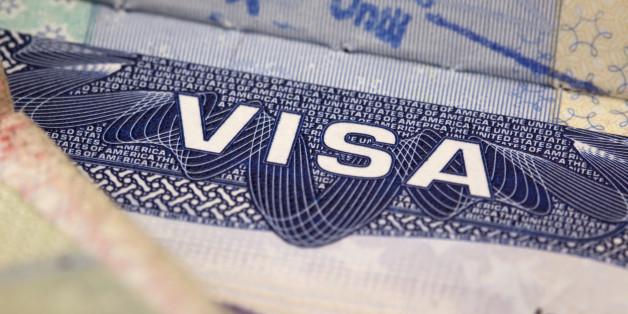 macro view of a segment of a US visa in a UK passport