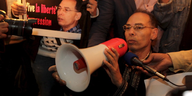 "Maati Monjib, a professor of political history and African studies at the University of Rabat and a writer for national and international news organisations, and his supporters participate in a demonstration near the ""Moroccan Human Rights Association"" (AMDH) in Rabat October 28, 2015. Monjib started a second hunger strike after authorities banned him from boarding a plane to Norway for an international conference on journalism in Lillehammer. REUTERS/Stringer"