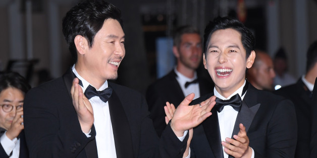 CANNES, FRANCE - MAY 24:  (L-R) Actors Kyoung-gu  Sul and Yim Si-wan attend the 'The Merciless (Bulhandang)' screening during the 70th annual Cannes Film Festival at Palais des Festivals on May 24, 2017 in Cannes, France.  (Photo by Dominique Charriau/WireImage)