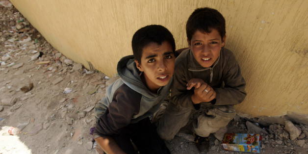 Two homeless children hide from the police near the port in Tangier, July 11, 2007. Approximately two thousand homeless minors live on the streets of Tangier according to the Al Jaima association, an association that works with street kids, and most of them are victims of the drugs and the prostitution. REUTERS/Rafael Marchante (MOROCCO)