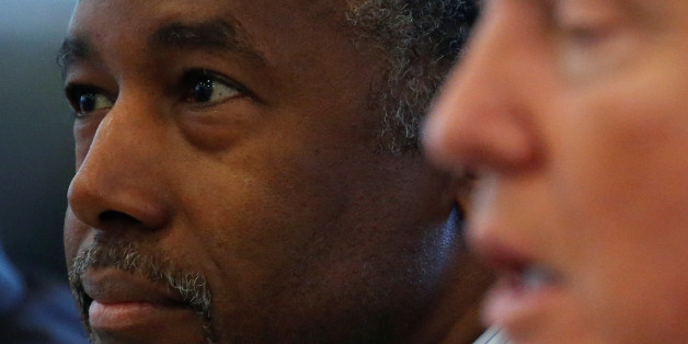 Dr. Ben Carson (L) and Republican presidential nominee Donald Trump speak during a round table with the Republican Leadership Initiative at Trump Tower in the Manhattan borough of New York, U.S., August 25, 2016.   REUTERS/Carlo Allegri