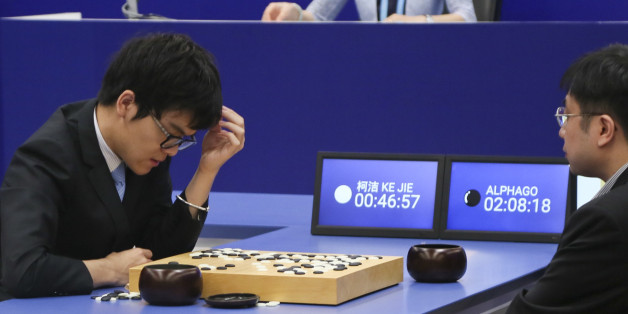 JIAXING, CHINA - MAY 25:  Chinese Go player Ke Jie (L) competes against Google's artificial intelligence programme AlphaGo during the their second match on day two of Future of Go Summit in Wuzhen on May 25, 2017 in Jiangxi, Zhejiang Province of China. Google's artificial intelligence programme AlphaGo faces with word top Go player Ke Jie during the Future of Go Summit from May 23 to 27 in Wuzhen.  (Photo by VCG/VCG via Getty Images)