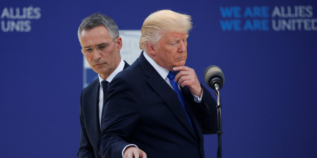 U.S. President Donald Trump reacts as he speaks beside NATO Secretary General Jens Stoltenberg at the start of the NATO summit at their new headquarters in Brussels, Belgium, May 25, 2017.REUTERS/Jonathan Ernst