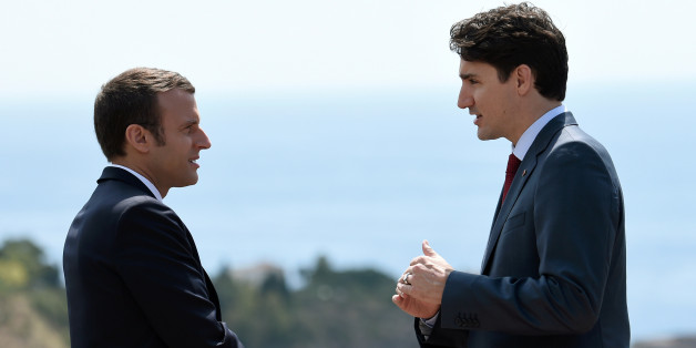 Canadian Prime Minister Justin Trudeau (R) and French President Emmanuel Macron talk as they attend the G7 Summit in Taormina, Sicily, Italy, May 26, 2017.   REUTERS/Stephane De Sakutin/Pool