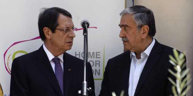 Greek Cypriot President Nicos Anastasiades (L) and Turkish Cypriot leader Mustafa Akinci (R) talk during a social function in Nicosias UN-patrolled buffer zone on June 2, 2016. 