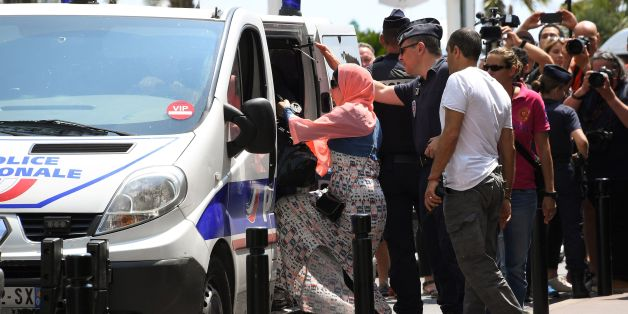A woman enters a Police van after being arrested by Police on May 26, 2017 outside the luxury Martinez hotel, before she attempted with other women to take part in a bathing in full-body Islamic burkini swimsuit on a beach of Cannes, during the 70th edition of the Cannes Film Festival in Cannes, southern France. 