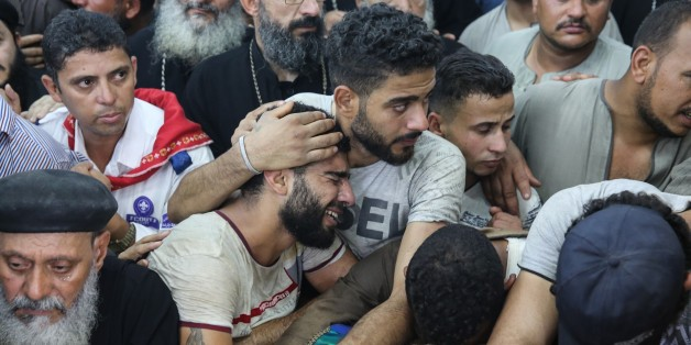CAIRO, EGYPT - MAY 26: Relatives of Saint Samuel's Monastery attack victims Cercis Mahrous and Beshavi Ibrahim mourn during a funeral ceremony at Maghagha Church in Cairo, Egypt on May 26, 2017. Attackers opened fire on a bus carrying Coptic Christians in Egypts southern Minya province, in Cairo, Egypt on May 26, 2017. It is reported that total of 26 people were killed in the attack. (Photo by Ahmed Al Sayed/Anadolu Agency/Getty Images)