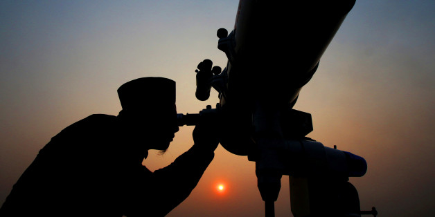An official looks through a telescope for the sighting of the new moon for the start of the Muslim fasting month of Ramadan at a religious boarding school in Jakarta, Indonesia May 26, 2017 in this photo taken by Antara Foto.   Antara Foto/Rivan Awal Lingga/via REUTERS  ATTENTION EDITORS - THIS IMAGE WAS PROVIDED BY A THIRD PARTY. FOR EDITORIAL USE ONLY. MANDATORY CREDIT. INDONESIA OUT. NO COMMERCIAL OR EDITORIAL SALES IN INDONESIA.     TPX IMAGES OF THE DAY