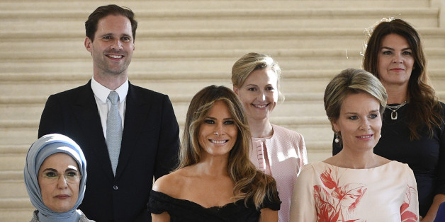 (Front row LtoR) First Lady of Turkey Emine Gulbaran Erdogan, First Lady of the US Melania Trump, Queen Mathilde of Belgium, (back row, LtoR) First Gentleman of Luxembourg Gauthier Destenay, partner of Slovenia's Prime Minister Mojca Stropnik and First Lady of Iceland Thora Margret Baldvinsdottir pose for a family photo before a diner of the First Ladies and Queen at the Royal castle in Laken/Laeken, on May 25, 2017, in Brussels. / AFP PHOTO / BELGA / YORICK JANSENS / Belgium OUT        (Photo c