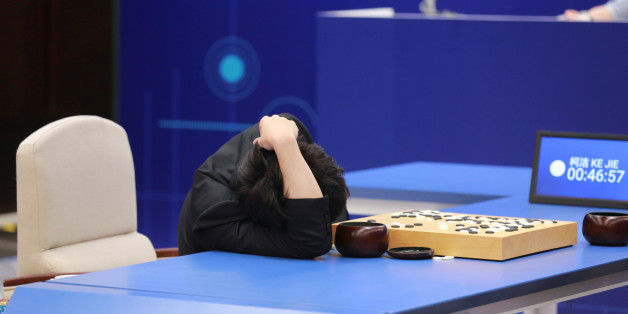 Chinese Go player Ke Jie reacts during his second match against Google's artificial intelligence program AlphaGo at the Future of Go Summit in Wuzhen, Zhejiang province, China May 25, 2017. REUTERS/Stringer ATTENTION EDITORS - THIS IMAGE WAS PROVIDED BY A THIRD PARTY. EDITORIAL USE ONLY. CHINA OUT.