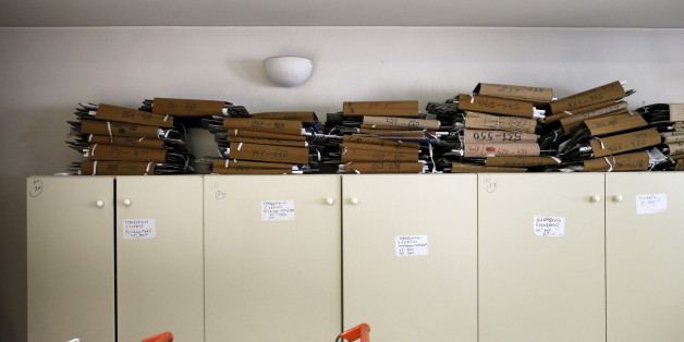 Tax archives are seen piled up inside a tax office in Athens, Greece, June 25, 2015. Monthly reports by Greece's financial crimes units highlight just how common tax dodging is, from doctors to farmers to contractors and civil servants. That, and the prevalence of small- and medium-sized businesses and the self-employed, as well as the sizeable shadow economy, shows just how difficult it is to crack down on Greece's corruption and tax evasion, which leftist Prime Minister Alexis Tsipras has made one of his priorities. To match Insight EUROZONE-GREECE/TAXES REUTERS/Alkis Konstantinidis