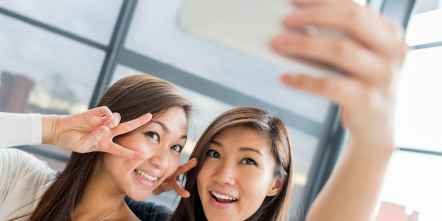 Asian women taking a selfie with a mobile phone