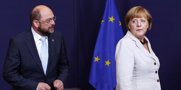 European Parliament President Martin Schulz (L) and Germany's Chancellor Angela Merkel (R) take part in a group photo during a EU summit in Brussels June 27, 2013. European officials struck two significant deals on banking resolution and their long-term budget in last-ditch negotiations early on Thursday, giving EU leaders a much needed lift before a summit on youth unemployment and growth.     REUTERS/Yves Herman (BELGIUM  - Tags: POLITICS BUSINESS EMPLOYMENT)