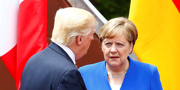 U.S. President Donald Trump and Germany's Chancellor Angela Merkel attend the G7 summit in Taormina, Sicily, Italy, May 26, 2017. REUTERS/Tony Gentile