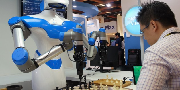 A visitor plays chess with a robot designed by Taiwan's Industrial Technology Research Institute (ITRI) during the Computex Show in Taipei on May 30, 2017.More then 5,000 booths from sixteen thousand companies take part in the annual computer and technology exhibition in Taipei between May 30 to June 3. / AFP PHOTO / SAM YEH        (Photo credit should read SAM YEH/AFP/Getty Images)