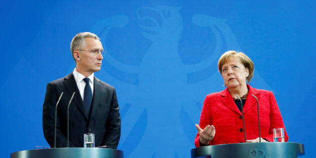 NATO Secretary-General Jens Stoltenberg and German Chancellor Angela Merkel address a news conference following their talks in Berlin, Germany, May 11, 2017.    REUTERS/Fabrizio Bensch