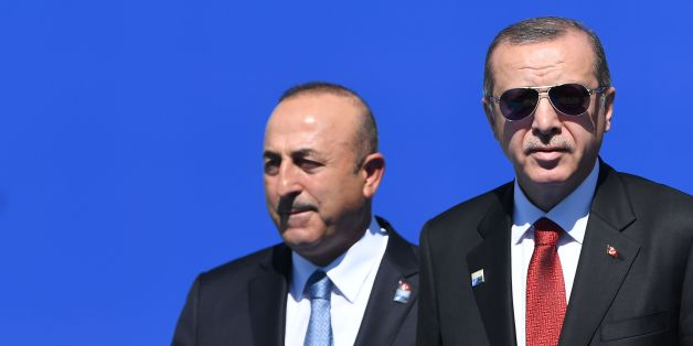 Turkish President Recep Tayyip Erdogan (R), flanked by Turkish Minister for Foreign Affairs Mevlut Cavusoglu (L), arrives for the NATO (North Atlantic Treaty Organization) summit at the NATO headquarters, in Brussels, on May 25, 2017. / AFP PHOTO / Emmanuel DUNAND        (Photo credit should read EMMANUEL DUNAND/AFP/Getty Images)