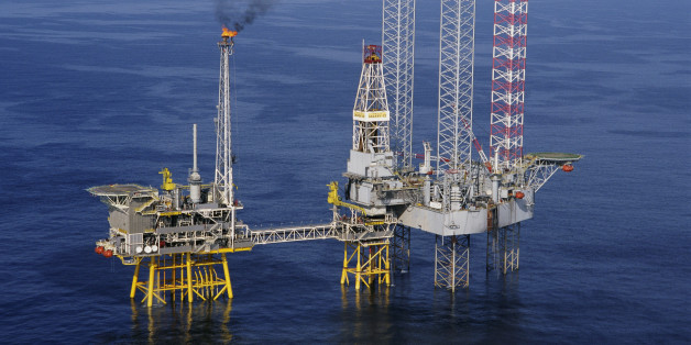 A Santa Fe Galaxy II platform drills a development well at the Thebaud Field natural gas production platform #1-84 in the Sable Island area of the North Atlantic. The Thebaud field is approximately 300 kilometers southeast of Halifax, Nova Scotia. The production platform is owned by Sable Offshore Operators Consortium, and the jack-up drilling platform (r) is owned by GlobalSantaFe Corporation.