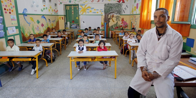 "Teacher Moulay Ismael Lamrani poses for a picture with his class in the Oudaya primary school in Rabat, September 15, 2015, at the start of the new school year in Morocco. Nearly three years after Taliban gunmen shot Pakistani schoolgirl Malala Yousafzai, the teenage activist last week urged world leaders gathered in New York to help millions more children go to school. World Teachers' Day falls on 5 October, a Unesco initiative highlighting the work of educators struggling to teach children amid intimidation in Pakistan, conflict in Syria or poverty in Vietnam. Even so, there have been some improvements: the number of children not attending primary school has plummeted to an estimated 57 million worldwide in 2015, the U.N. says, down from 100 million 15 years ago. Reuters photographers have documented learning around the world, from well-resourced schools to pupils crammed into corridors in the Philippines, on boats in Brazil or in crowded classrooms in Burundi.    REUTERS/Youssef BoudlalPICTURE 41 OF 47 FOR WIDER IMAGE STORY ""SCHOOLS AROUND THE WORLD""SEARCH ""EDUCATORS SCHOOLS"" FOR ALL IMAGES"