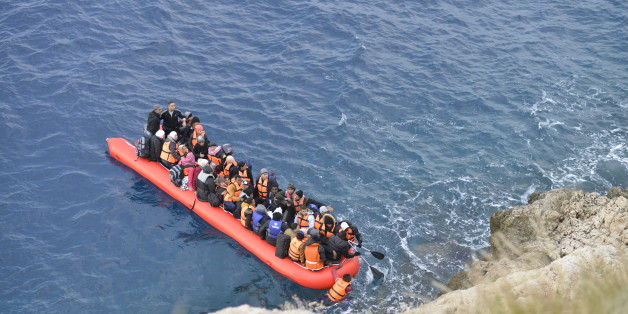 Kas,Turkey - January 16, 2016, Coast line between Kalkan Kas at 09:45. An inflatable boat filled with refugees and other migrants approaches the south coast of the Turkey. Picture captured from Kalkan Kas Road D400.